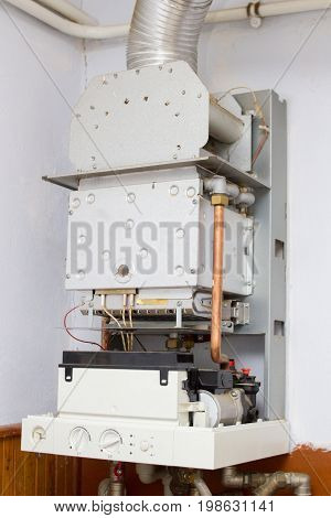 Repair of a gas boiler in the house on the wall