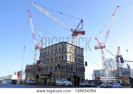 AUCKLAND - JULY 26 2017:Four cranes in a building site.A record 132 cranes are operating in cities around New Zealand.The construction boom is mostly in residential and commercial jobs in Auckland CBD