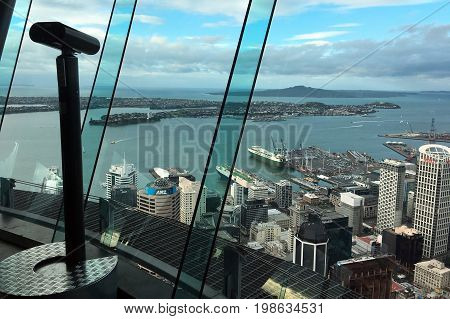 AUCKLAND - AUG 03 2017:The landscape view from Auckland's Sky Tower observation deck.The Sky Tower has stood tall at 328 meters as an icon of Auckland's sky line since 1997.