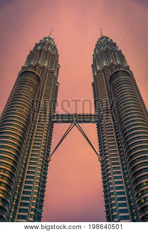 KUALA LUMPUR MALAYSIA - JULY 29 2017. Petronas Twin Towers skyscraper at sunset on July 29 2017. The tallest buildings in the world from 1998 to 2004 and remain the tallest twin towers in the world. The buildings are a landmark of Kuala Lumpur
