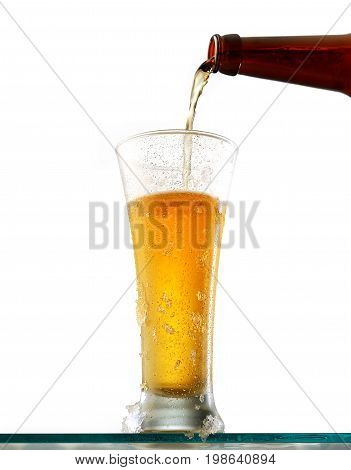 Glass of cold beer on a white background
