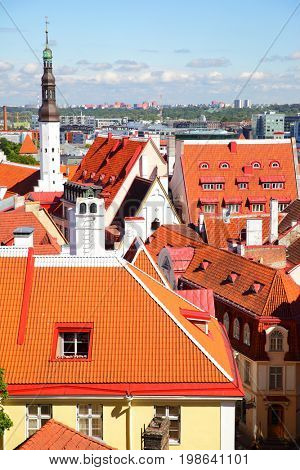 Red tiled roofs of Old town of Tallin with Holy Spirit Church tower, Estonia