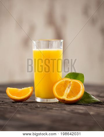 Fresh orange drink on wooden table. Fruit orangeade. Summer drink. orange orangeade.