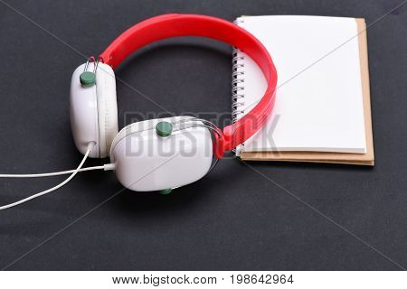 Music Accessories And Note Taking Concept. Headphones In White, Red