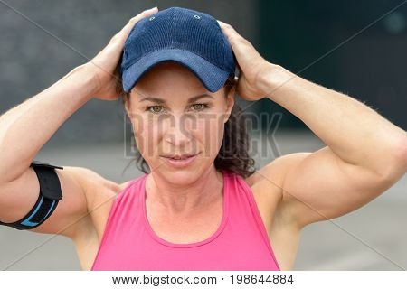 Cute Attractive Young Woman In A Baseball Cap
