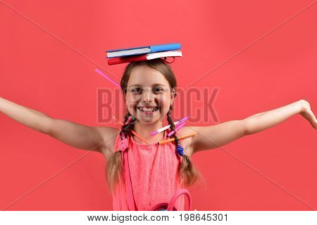 Back To School And Homework Concept. Girl Holds Books