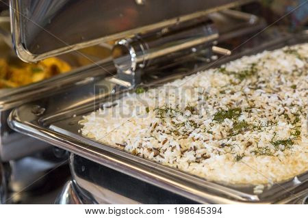 Chafing dish heaters rice banquet table. Close up