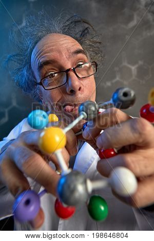 Crazy scientist building molecular atom model