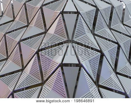 symmetrical metal modern panels with angular geometric design and square holes