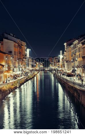 Naviglio Grande canal night life with restaurant and bars in Milan, Italy.