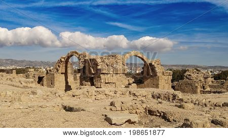Ancient ruins of Kourion city near Pathos and Limassol, Cyprus. Santa Colones Castle ruins with blue sky. Travel outdoor background