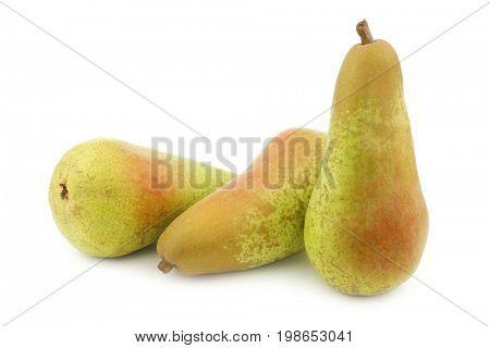 three fresh abate pears on a white background