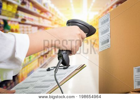 Supermarket Female cashier use code scanner customer checkout