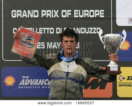 MILAN ITALY JUNE 24 Britains Oliver Pope standing on the Podium after winning both races of the S3 class at the FIM Supermoto World Championship CASTELLETTO DI BRANDUZZO ITALY