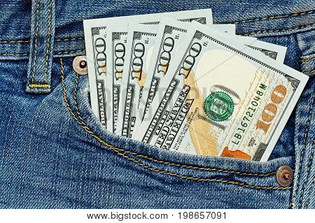 Few hundreds dollars in simple jeans pocket - close up capture - allowance or salary concept