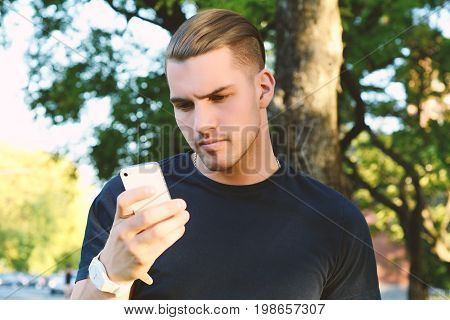 Latin Man Using His Smartphone. Outdoors.
