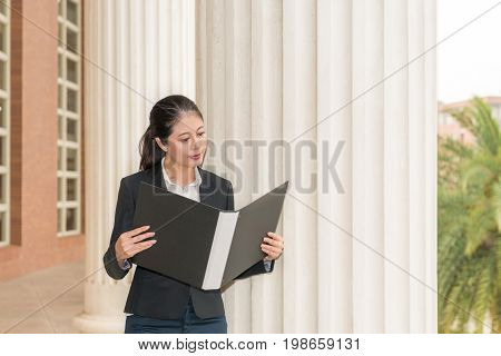 Businesswoman Lawyer Holding Folder And Reading