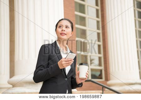 Smiling Female Lawyer Holding Coffee Paper Cup
