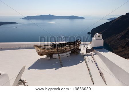 Wooden boat on the roof of the building. Thira (Fira) Santorini Island Greece