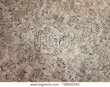brown and grey tiled floor with very irregular shapes