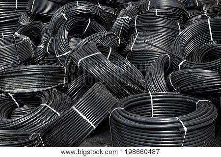 Coiled plastic pipes stored outdoors Coiled plastic pipes