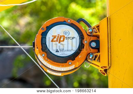 Ukraine Migea - July 30 2017: Close-up Automatic brake unit Head Rush Zip Stop for high-speed lines Zipline and for trolley lines. Equipment for safe trolling on a steel cable. Zipline.