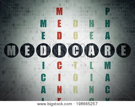 Health concept: Painted black word Medicare in solving Crossword Puzzle on Digital Data Paper background