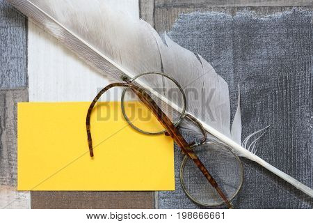 Vintage still life with old glasses and quill pen