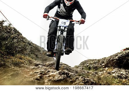 man rider downhill bicycle on mountain trail