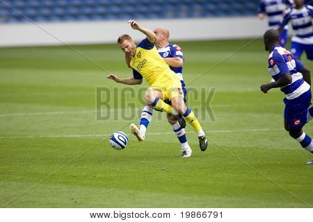 LONDON, UK AUGUST 2,Gavin Mahon tackles Michele Marcolini at the pre-season friendly football match between QPR and Chievo,