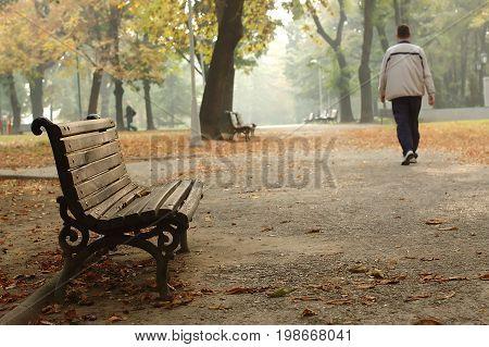 A men taking a walk in a park