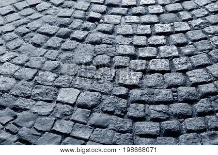 traditional and historic blue cobblestone, old road