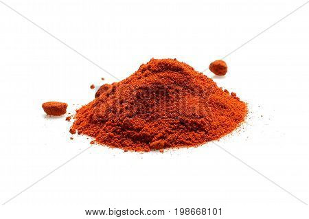 red chili powder on white, food ingredient