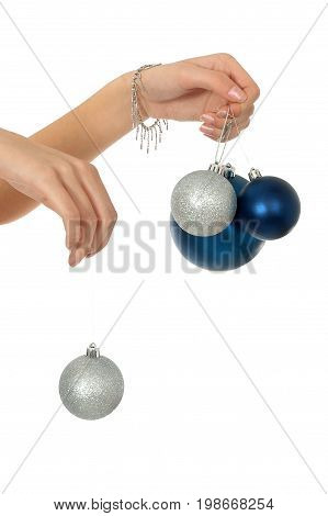 Woman holding a Christmas ornament, silver and blue ball