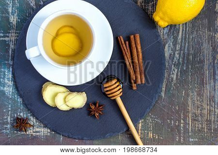 Ginger hot immunity boosting Vitamin natural drink With Lemon honey and cinnamon and ingredients.
