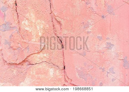 Worn pale red concrete wall texture background. Textured plaster
