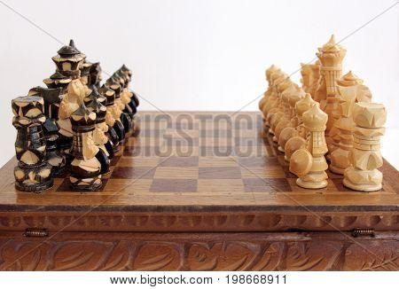 Vintage Handmade Chess Pieces On The Board