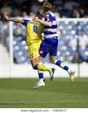 LONDON, UK AUGUST 2,Gareth Ainsworth and Mirco Gasparetto leap for the ball at the pre-season friendly football match between QPR and Chievo,