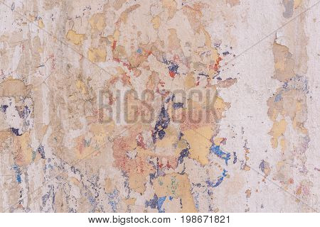 Worn Yellow pink white concrete wall texture background. Textured plaster