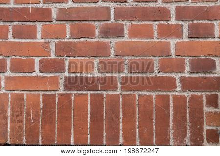 Old brick wall with redbricks in a beautiful patter