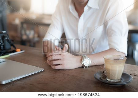 Mockup scene of adult freelance worker in coffee shop on weekend. Freelancer lifestyle concept