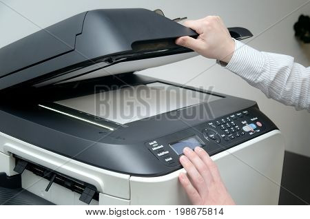 Man Using Scanner Device In Office
