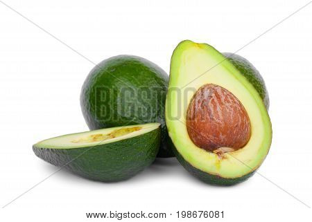 A heap of green avocados, isolated on a white background. A few whole and cut pear-shaped fruit with a rough leathery skin, edible flesh, and a large stone. Healthy food.