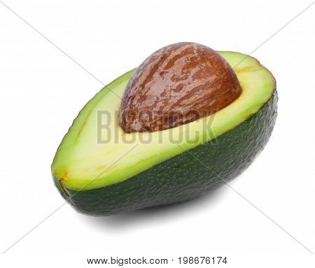 A single cut green avocado isolated over the white background. Nutritious and organic avocado for a spicy flavoring. Tropical, ripe and sliced avocado with hard core and juicy texture.