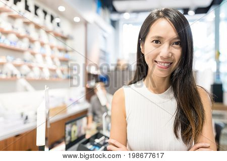 Young Woman holding small business in optician store