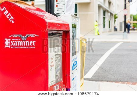 Washington DC USA - July 3 2017: Newspaper kiosks vending machines on National Mall with National Examiner