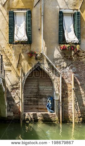 Old building along canals in Venice Italy