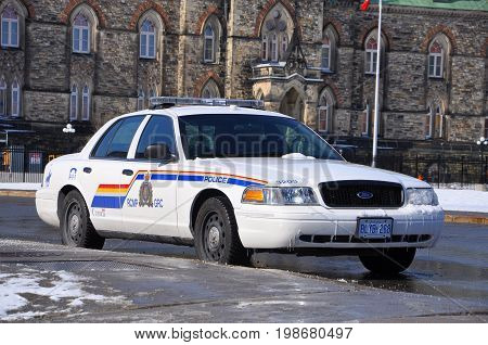 OTTAWA, CANADA - MAR. 10, 2012: RCMP Royal Canadian Mounted Police Ford Crown Victoria Police Car on Parliament Hill in Ottawa, Ontario, Canada.