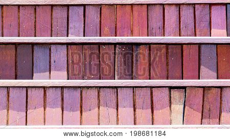 The wood is laid out in a neatly arranged order with sheets of dividers and a place of wood wood is bright red.