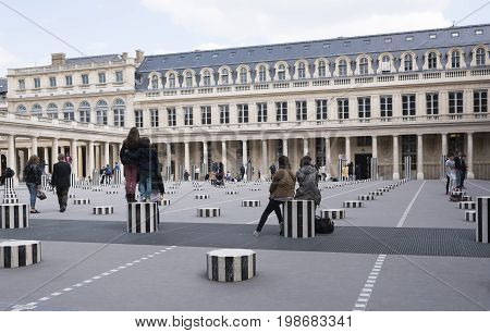 ParisFrance- April 29 2017: Les Deux Plateaux; art installation by Daniel Buren in the inner courtyard of the Palais Royal .This artwork was created in 1985-1986.